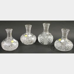 Four Colorless Cut Glass Carafes.