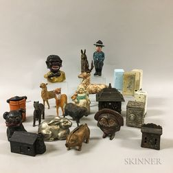 Twenty-two Mostly Cast Iron Architectural and Figural Still Banks