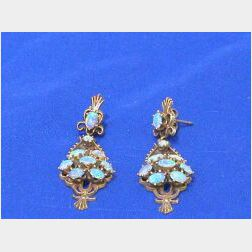 14kt Gold and Opal Earrings.