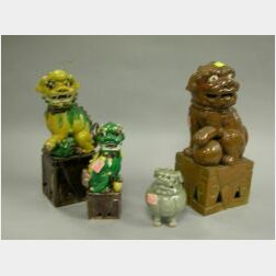 Three Chinese Glazed Ceramic Foo Dogs and a Celadon Glazed Foo Dog Incense Burner.