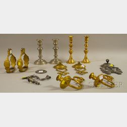Seven Pieces of Brass and Pewter Lighting and a Pair of Brass Stirrups