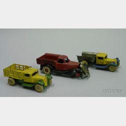 Three Cast Iron Trucks
