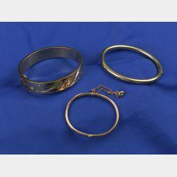 Three 14k Gold Bangle Bracelets