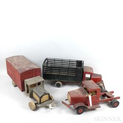Six Painted Wood and Tin Trucks.     Estimate $20-200