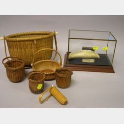 Two Nantucket Woven Baskets and Four Miniature Nantucket Baskets, with a Scrimshaw Sailin   Susan Decorated Resin Whale's Tooth