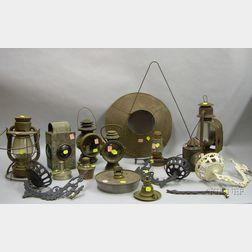 Seven Assorted Metal Kerosene Lanterns, Three Cast Iron Wall Brackets, and Lighting   Parts