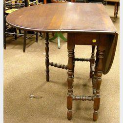 William & Mary Style Mahogany Veneer Drop-leaf Gate-leg Table.