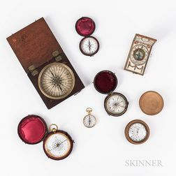 Six Pocket Compasses and a Diptych Sundial