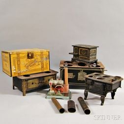 Four Miniature Stoves, a Steam Engine, and an Advertising Tin