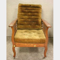 Late Victorian Oak Spindle-sided Adjustable-back Morris Chair with Velvet   Upholstered Cushions.