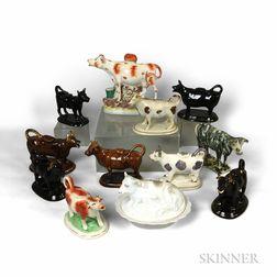 Twelve Ceramic Cows and Cow Creamers