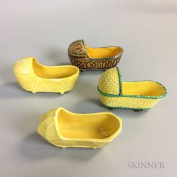 Four Staffordshire Yellow-glazed Ceramic Cradles