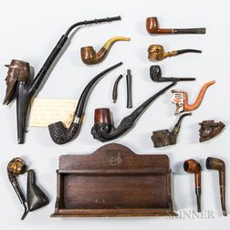 Group of Carved Pipes and a Rack