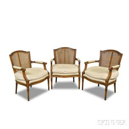 Set of Three Louis XVI-style Caned Fruitwood Fauteuil