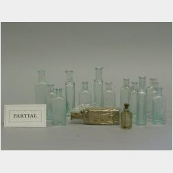 Collection of  Forty-six Dr. Seth Arnold's Balsam and Cough Killer Aqua and Clear   Glass Bottles.