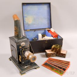 Cased Magic Lantern with Slides and Accessories.     Estimate $20-200