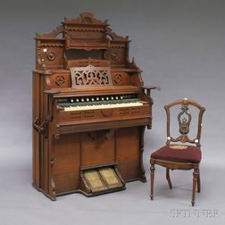 Eastlake Style Walnut Pump Organ and a Renaissance Revival Carved and Ebonized   Walnut Side Chair