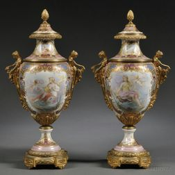 Pair of Gilt-bronze-mounted Sevres Porcelain Urns and Covers