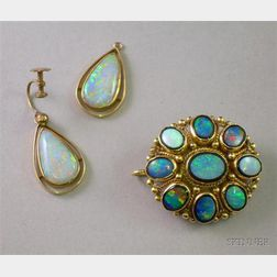 14kt Gold, Onyx , and Opal Pendant/Brooch and a Pair of 9kt Gold and Opal Earrings