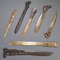 Seven Bronze Letter Openers