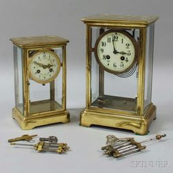 Two Brass and Glass Crystal Regulators
