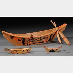 Three Northwest Coast Canoes with Paddles