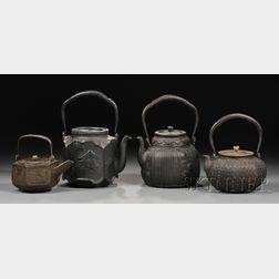 Four Cast Iron Kettles