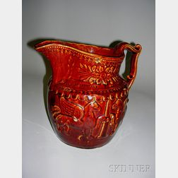 Molded Rockingham Glazed Pottery Pitcher with Griffins and Monument