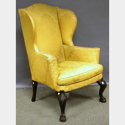 Chippendale-style Gold Damask-upholstered Carved Mahogany Wing Chair.