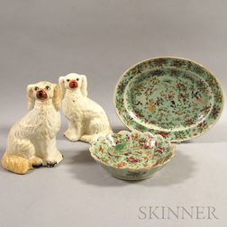Two Famille Rose Porcelain Platters and a Pair of Staffordshire Spaniels.     Estimate $200-250