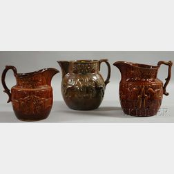 Three Bennington and Rockingham Glazed Molded Pottery Pitchers with Griffin   Decoration