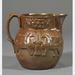 Molded Albany Slip Glazed Pottery Pitcher with Griffins