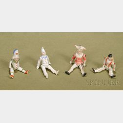 Four Small All-Bisque Novelty Dolls