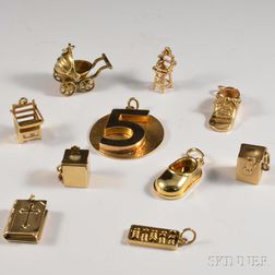 Nine 14kt Gold Child-themed Charms