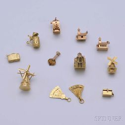 Twelve 14kt Gold Travel-themed Charms