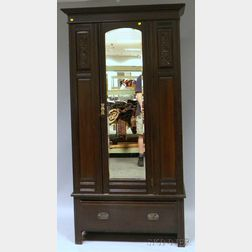 Late Victorian Walnut-finished Carved Wood and Mirrored Armoire with Long Drawer.