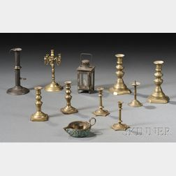 Eleven Miniature Brass and Iron Early Lighting Devices