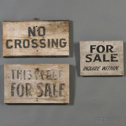Three Black and White Painted Signs