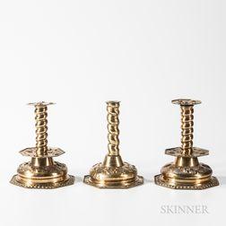 Three Dutch Brass Repousse Candlesticks