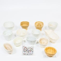 Collection of Pottery Molds and a Group of Decorated Ceramic Marbles
