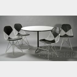 Four Charles and Ray Eames Chairs and a Table