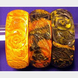 "Set of Three Bakelite ""End of Day"" Carved Bangles"