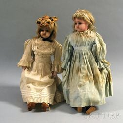 Two Wax Girl Dolls