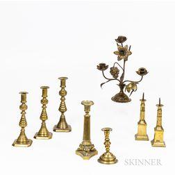 Eight Brass Candlesticks