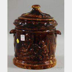 Large Rockingham Glazed Molded Pottery Jar with Cover