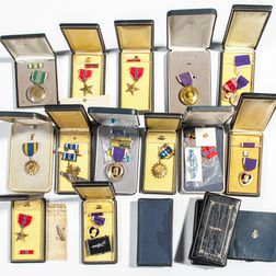Cased and Mostly Identified Military Medals and Three Empty Cases