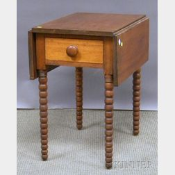 Cherry Drop-leaf Table with End Drawer and Spool-turned Legs.