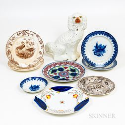 Eight Transfer-decorated Plates and a Staffordshire Spaniel