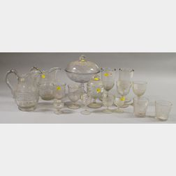 Sixteen Pieces of Colorless Pressed Holly Pattern Glass Tableware