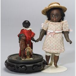 "Four Black ""Primitive"" Cloth Dolls"